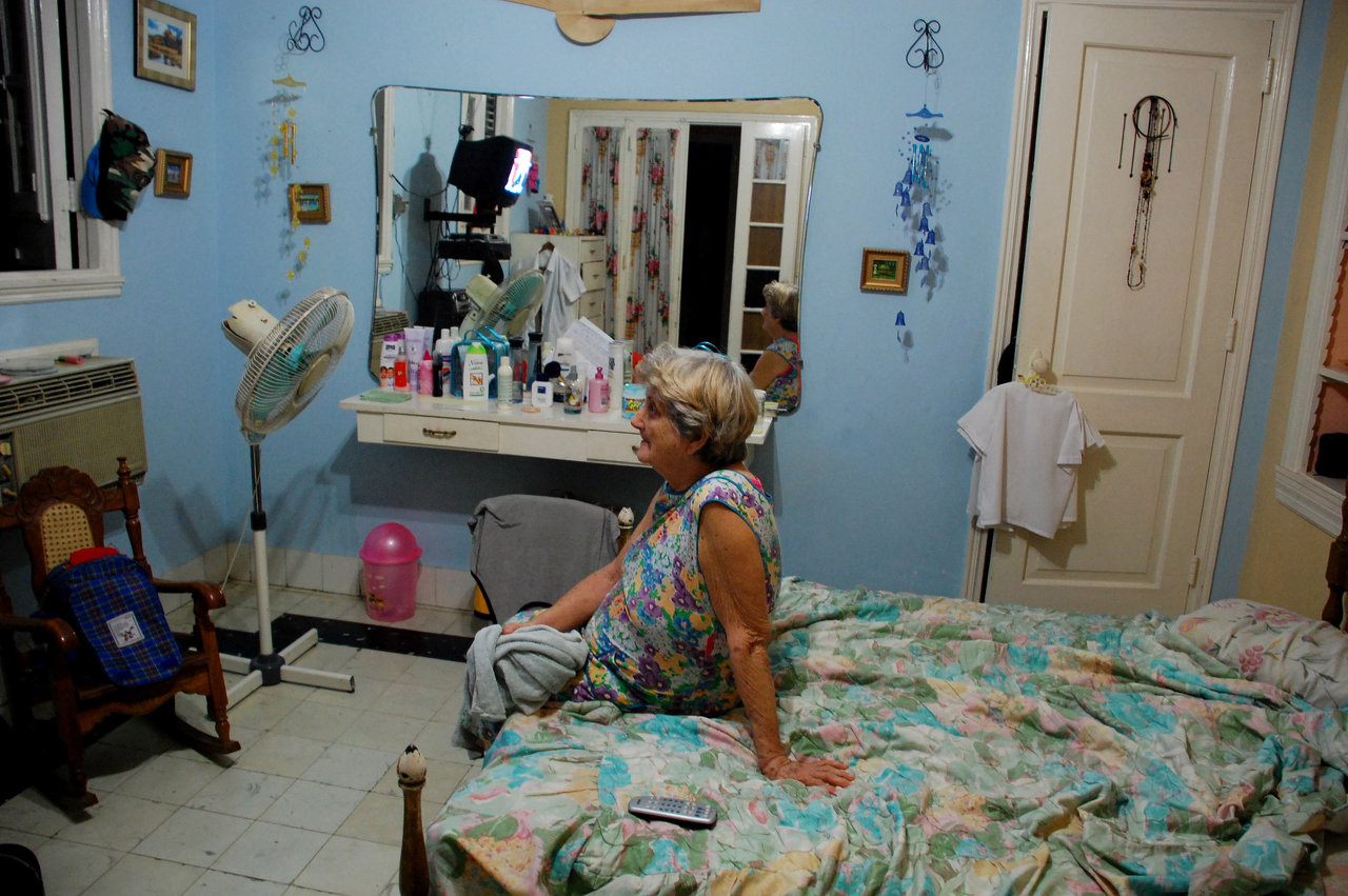 Aracelis watches the inauguration of Raul Castro on television, Havana, 2008