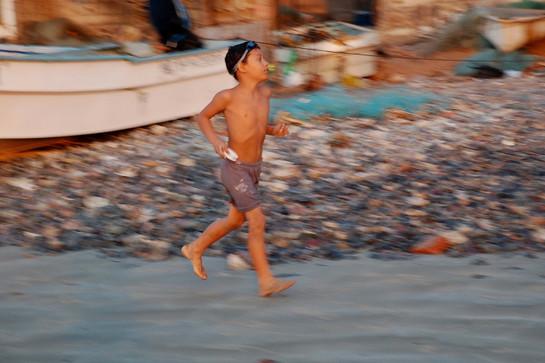 A boy runs on the beach, La Manzanilla, 2008.