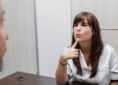 Speech Therapist training patient
