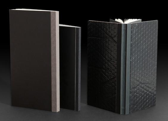 ספר בכריכה קשה, חיתוך בלוק, קרטון מצופה בחומרים שונים.