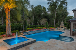 custom pool at night water features