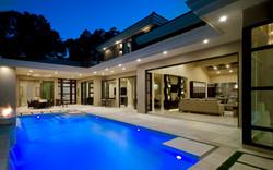 luxury pool with multiple waterfalls