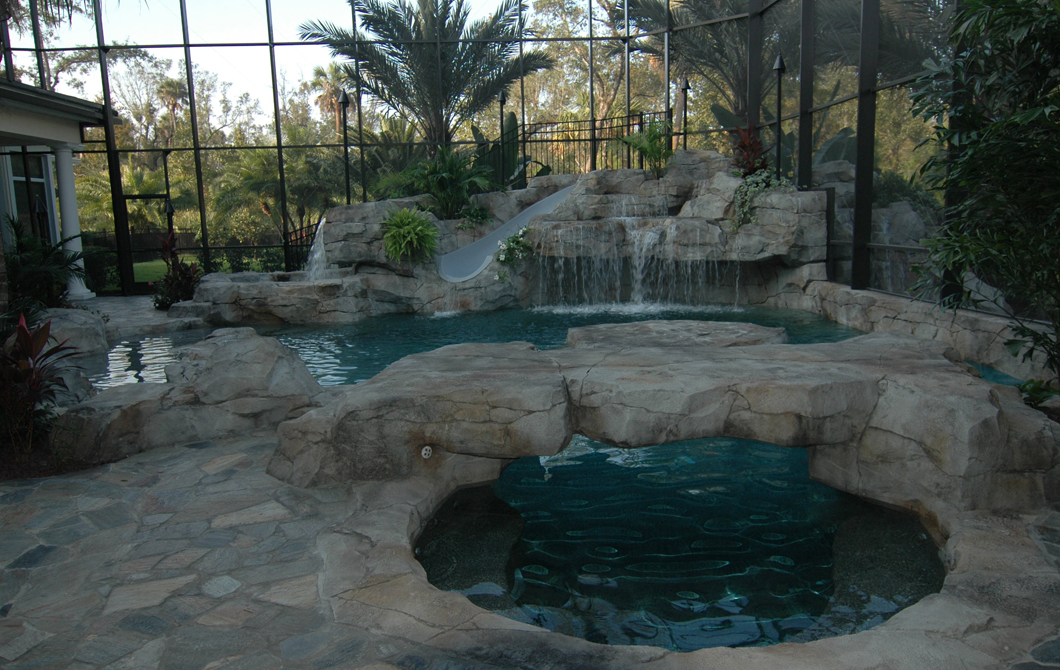custom rock edge pool with slide