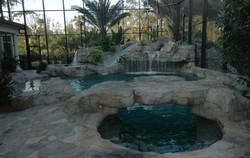 custom rock edge pool with slide