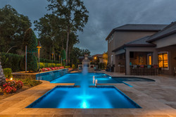pool at night with bubbler and spa
