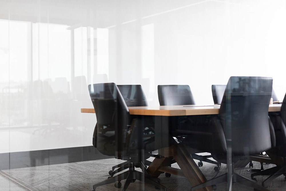 Image of meeting room table and chairs.