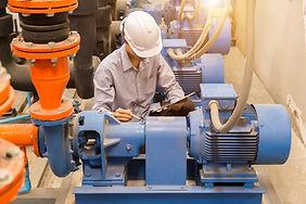 Asian engineer maintenance checking tech