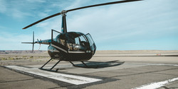 black%20helicopter%20on%20railway%20unde