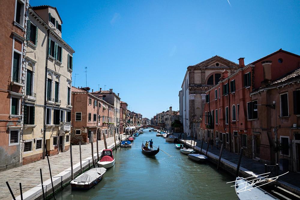 A trainee gondolier zig-zags along the Rio de San Girolamo, Venice, Italy.