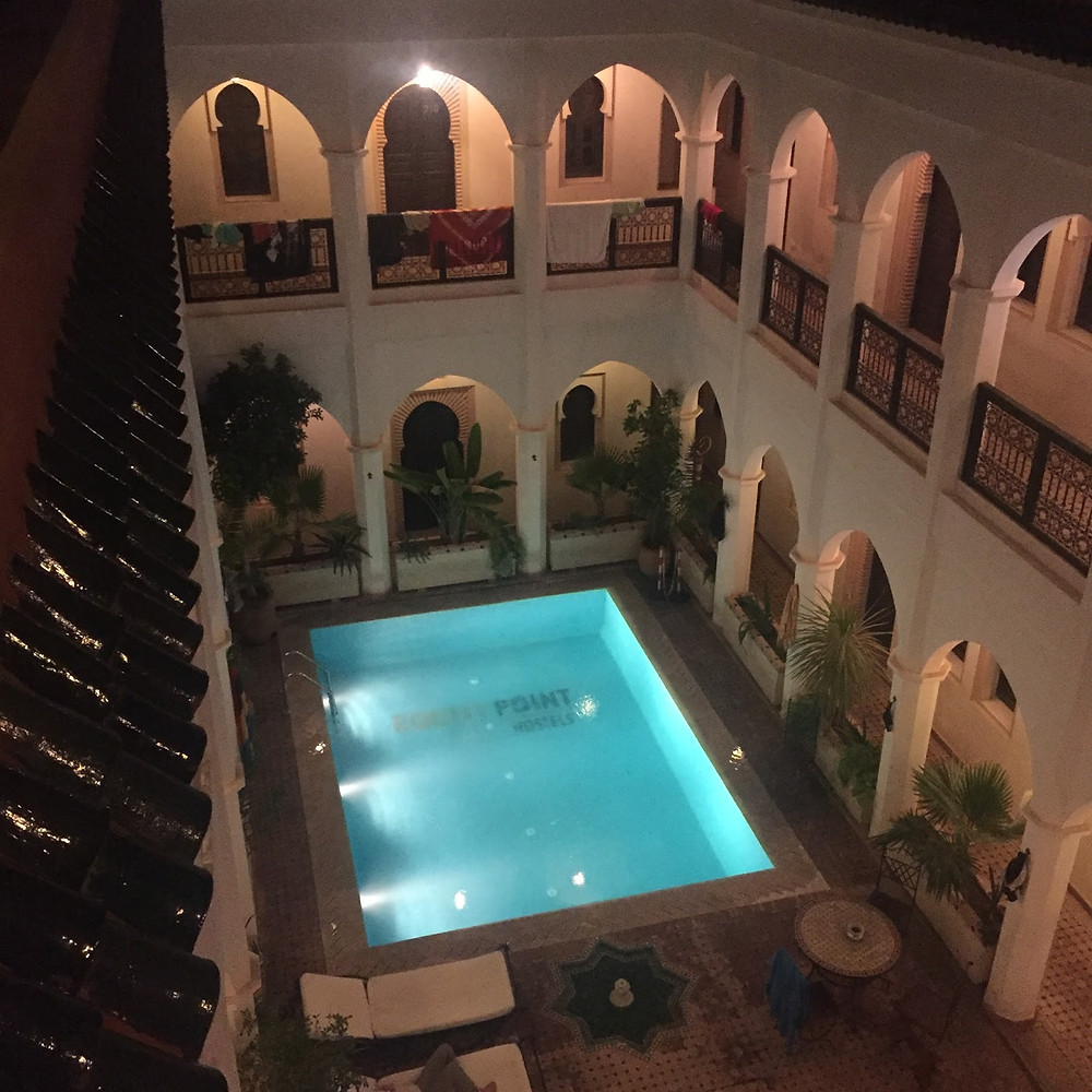Looking down at the pool and dorm 108 at Equity Point Hostel, Marrakech.
