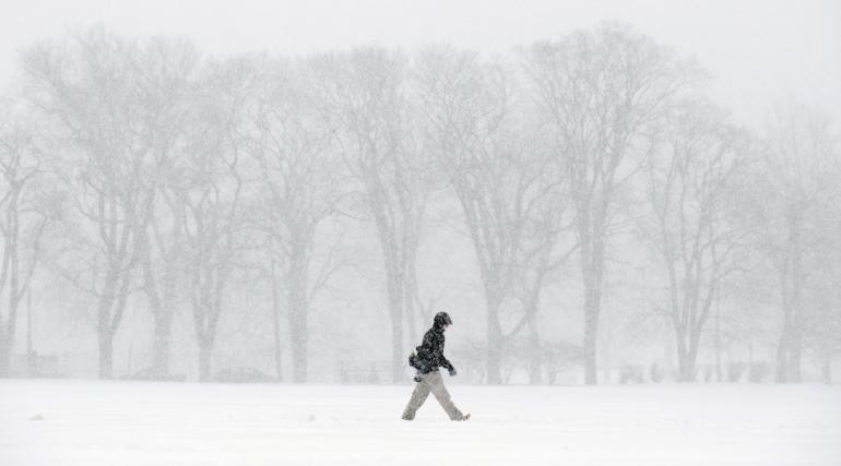 456082-a-pedestrian-braves-the-elements-during-a-winter-storm-on-january-22-2