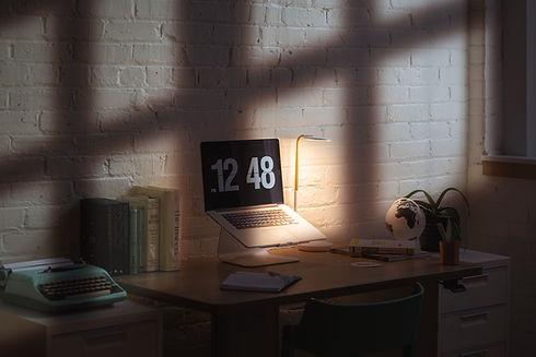 laptop in room prepared for zoom meetings