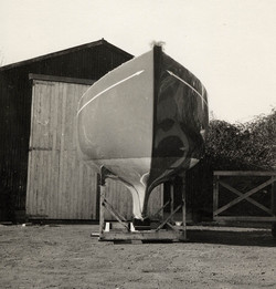 Humble beginnings  -  the hull of Sunrise outside the shed at South Heighton