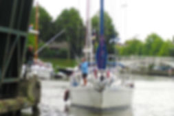 Paying bridge fee in the traditional way (Mast up Route Dokkum)