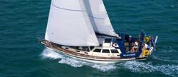 """""""Maunie"""" under full sail"""