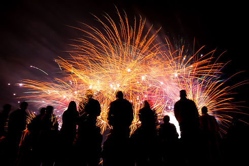 Big fireworks with silhouettes of people