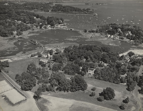 Aerial view of Bayley Beach area with the tennis courts in the lower left of the photo, 1960.