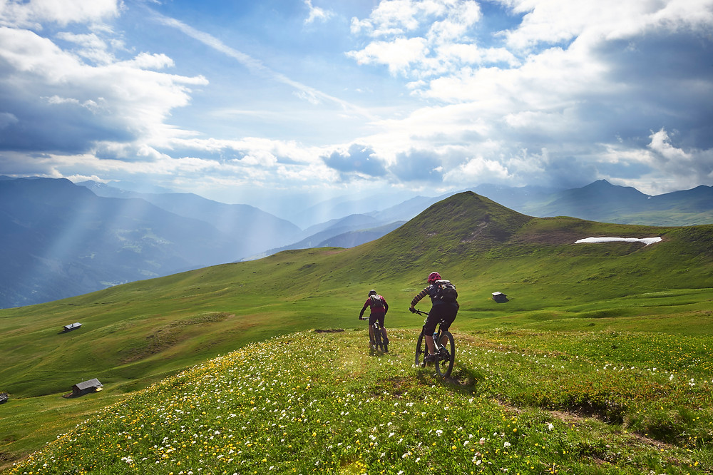 Biking in the Swiss Alps with Tschuggen Grand Hotel.