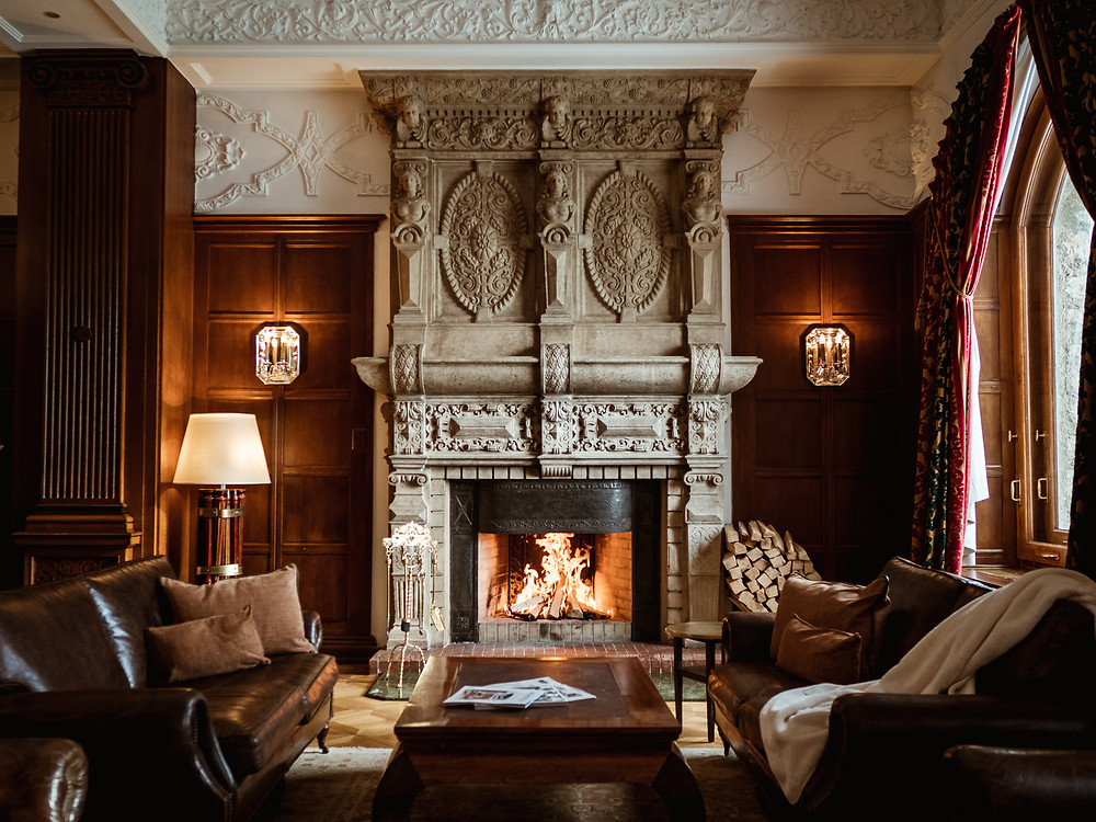 The library and fireplace at the Carlton Hotel St. Moritz