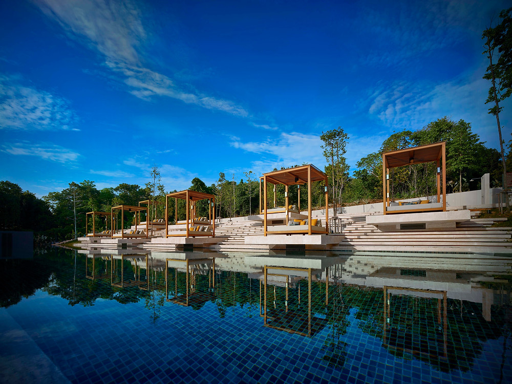 The pool at The Ritz-Carlton, Koh Samui with overhanging lounge areas