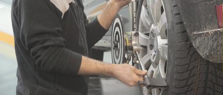 Vehicle Maintenance Photo of Repair Man Changing Tire
