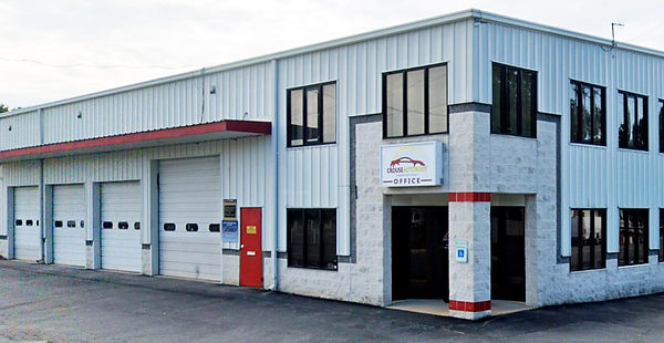 The front view of Crouse Auto Body's building