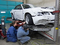 Collision Repair photo of technicisnas working on front bumper