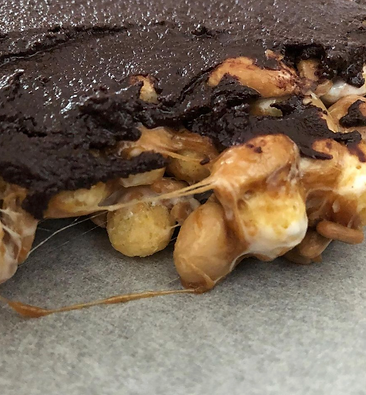 Homemade chocolate covered nut crunch candy bars