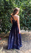 Dark navy dress with metallic twist details and godets