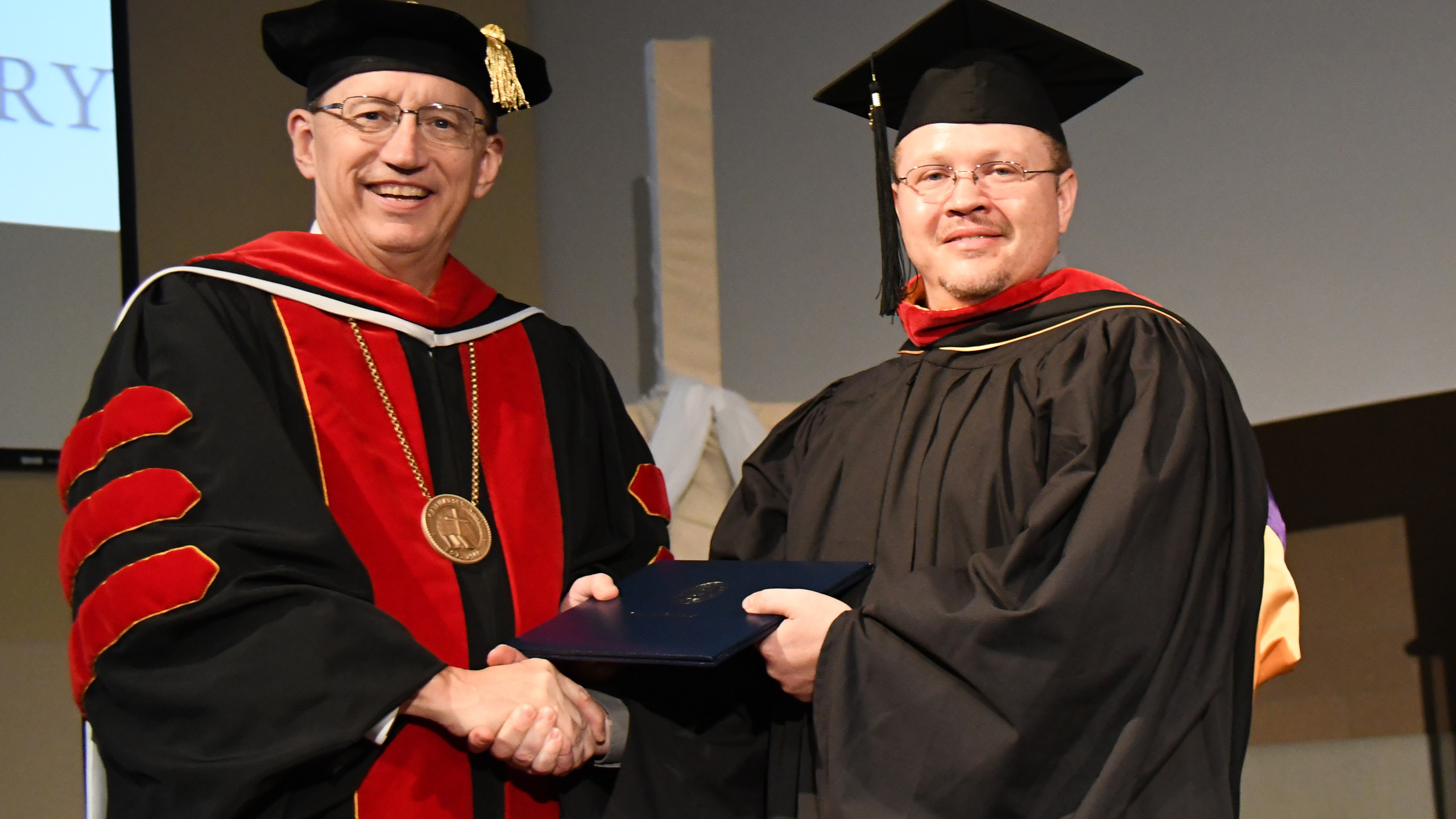 Finally! Mark receiving his diploma after completing a Master of Divinity degree with a concentration in Biblical Studies.