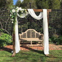 Rustic arbour w draping & flowers