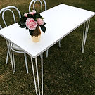 white hairpin signing table