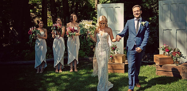 Rustic wedding ceremony with white rustic doors