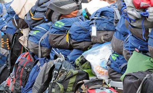 Pile-of-Backpacks.webp