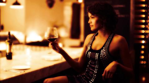 beautiful-sexy-woman-drinks-wine-in-a-ho