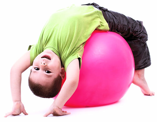 Little boy doing gymnastic exercises with a large rubber ball_edited.jpg