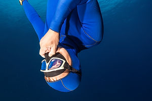 Freediver descending with monofin. Free