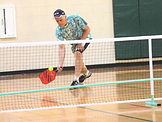 Pickleball player in gym.png