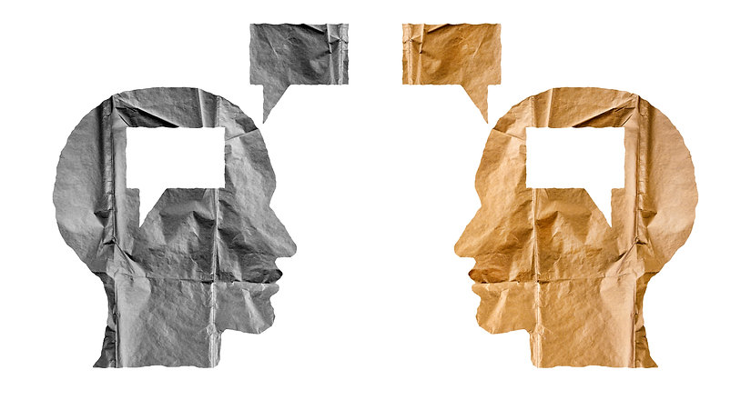 Crumpled paper shaped as a human heads a
