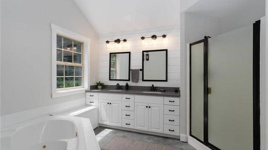 Double sinck and spacious shower with seat.