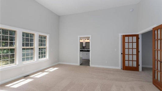 Master Bedroom with a double-door entry..