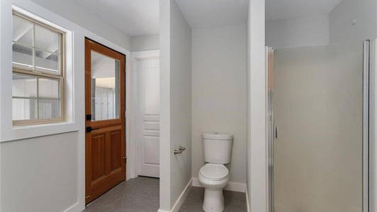 Laundry room and half bath with door to mechanical and water heatre, plus wrap around deck.