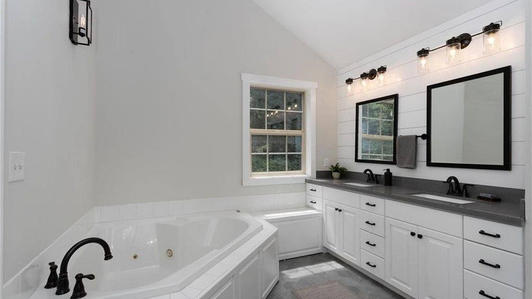 Master bath, with jacuzzi, shower and toilet not showing.