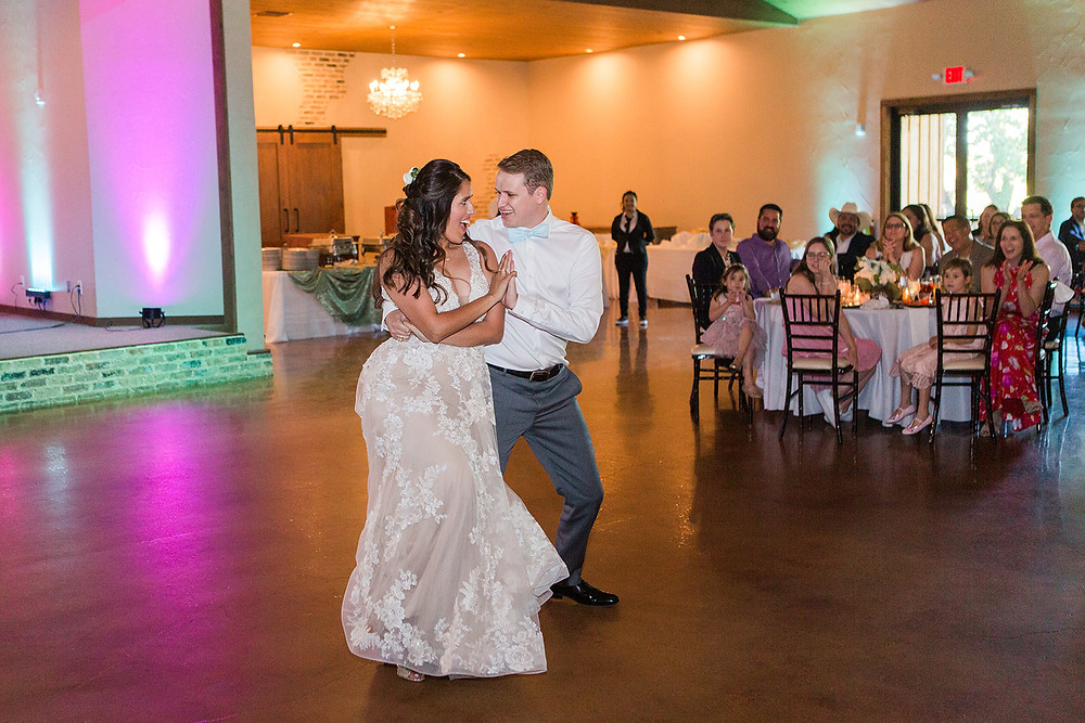 new Mr. & Mrs. having a blast with their salsa first dance