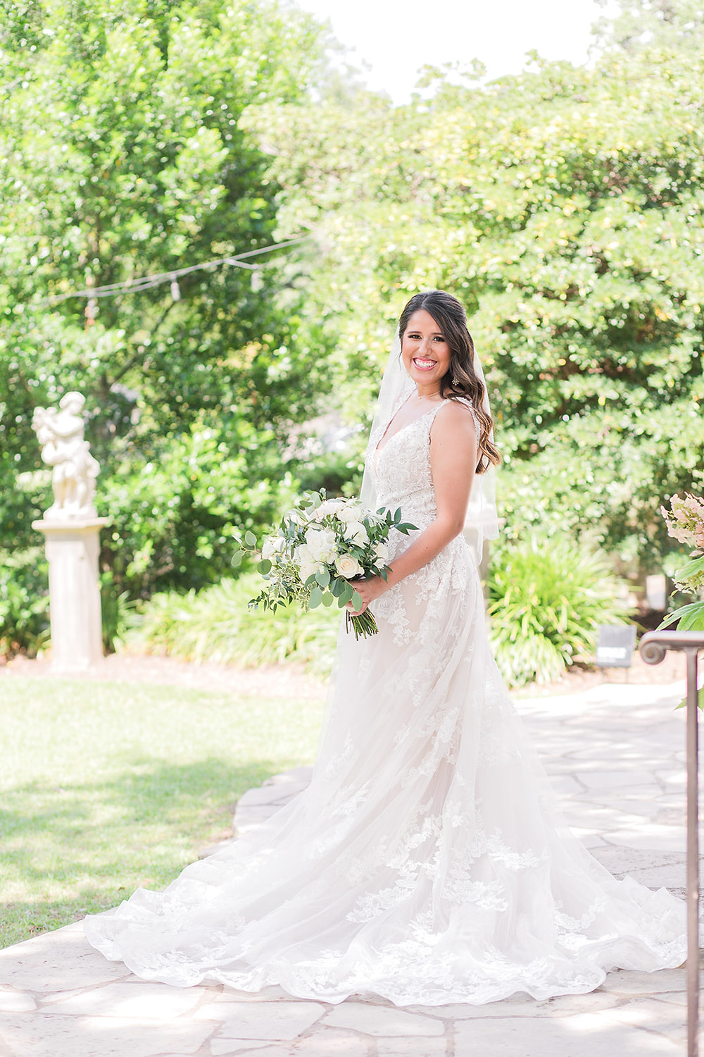 Blushing bride in lace gown