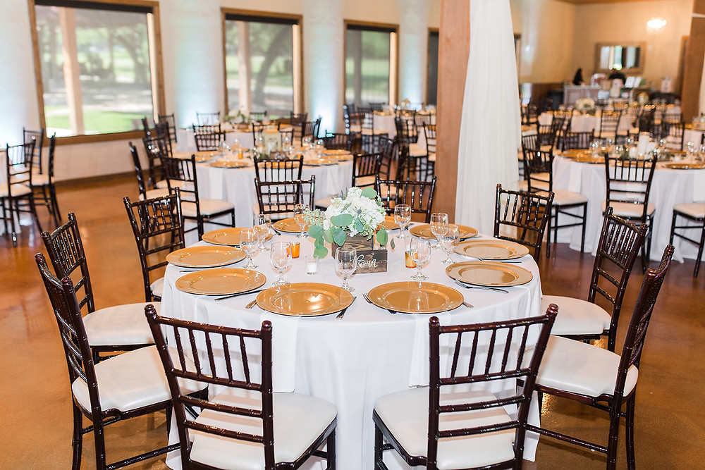 Table setting with white linen and gold accents