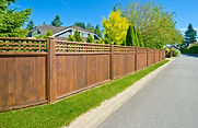 Long wooden cedar fence on the empty str