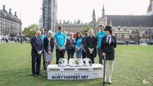 Campaigners held a mock funeral procession in Parliament Square