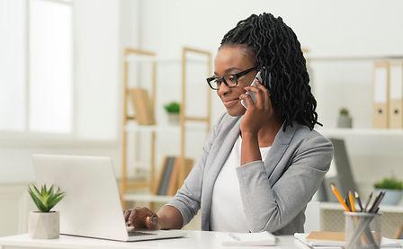 black-entrepreneur-girl-talking-on-cellp