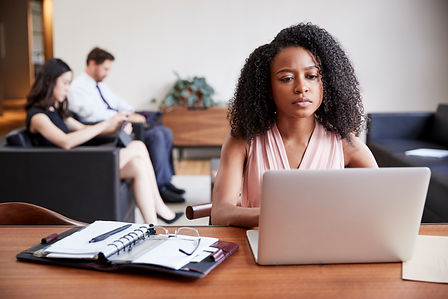 young-black-businesswoman-using-laptop-a